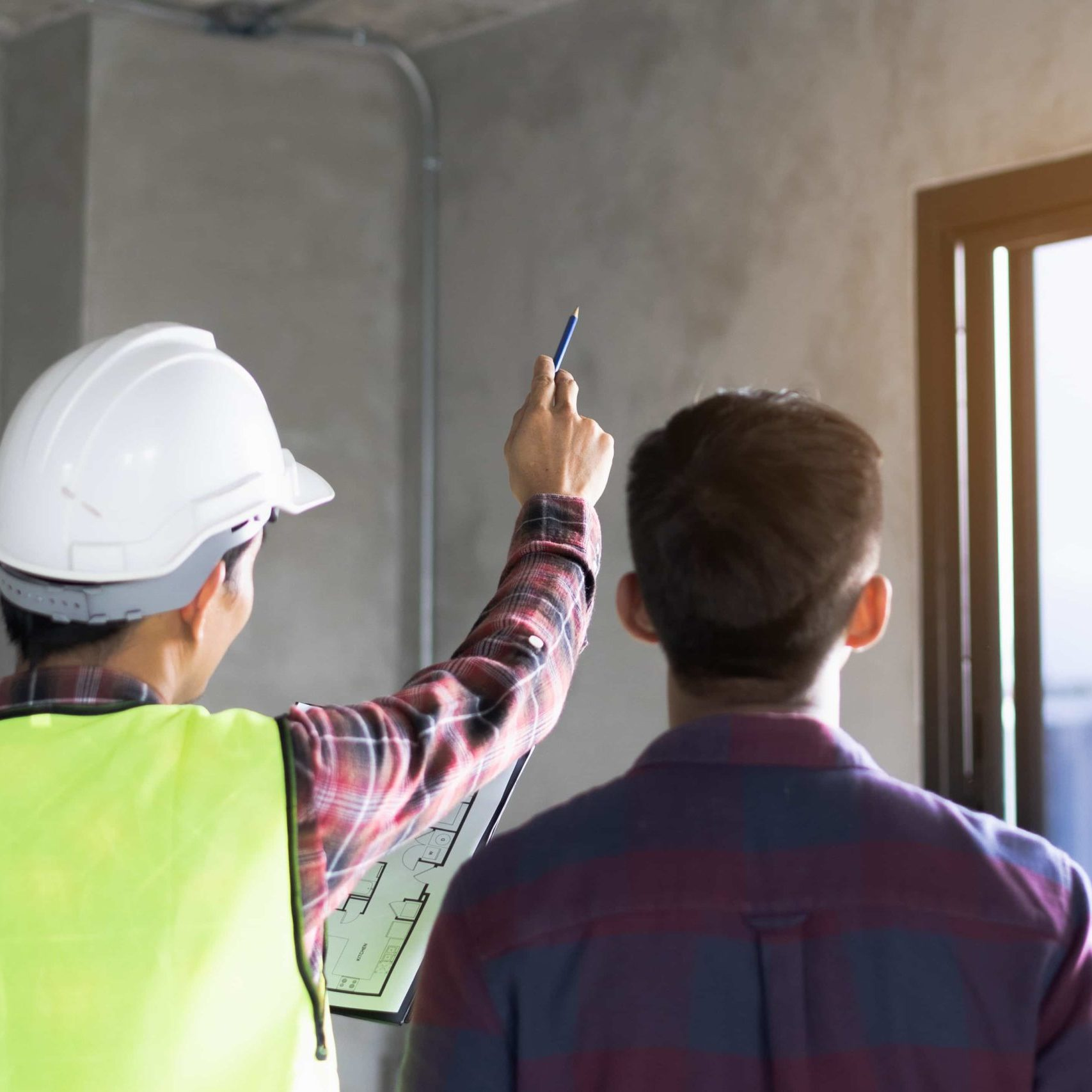 Client and Contractor discussing plan to renovation house.